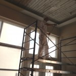 Painting a wood ceiling in a downtown loft
