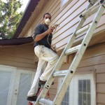 Sam spraying exterior siding