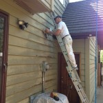 Paul prepping siding by sanding